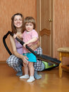 Family with vacuum cleaner Stock Photography