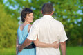 Family Values Concepts and Ideas. Two Caucasian Mature Adults Enjoying Together Outdoors. Walking Embraced in Park Royalty Free Stock Photo