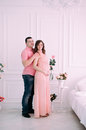 Family waiting for baby`s birth. A pregnant woman and her husband wearing white clothing Royalty Free Stock Photo