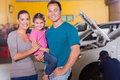 Family waiting in garage young while their car serviced Stock Image