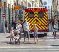 Family waits at the sideway to cross the street marseille france july an ambulance car with reanimation parks in pedestrian Stock Images
