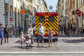 Family waits at the sideway to cross the street marseille france july an ambulance car with reanimation parks in pedestrian Royalty Free Stock Photos