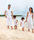 Family walk on the beach Royalty Free Stock Photo