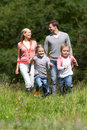 Family on walk in countryside smiling Royalty Free Stock Images
