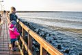 Family walk on Darlowo pier Royalty Free Stock Photo