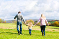 Family walk through the park in fall Royalty Free Stock Photo