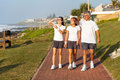 Family walking beach active healthy by the in the morning Stock Photo