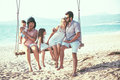Family walking on the beach Royalty Free Stock Photo