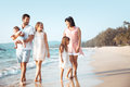 Family walking on the beach Royalty Free Stock Photo