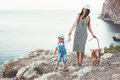 Family walking with dog Royalty Free Stock Photo