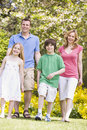 Family walking outdoors smiling Royalty Free Stock Photos