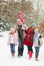 Family Walking Through Snowy Woodland Stock Photography