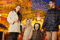 Family walking together at the holiday evening Royalty Free Stock Photo