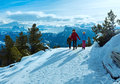 Family walking on winter mountain slope mother with two children take a walk rittner horn italy Royalty Free Stock Images