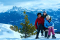 Family walking on winter mountain slope mother with two children take a walk view from rittner horn puez geislergruppe left italy Royalty Free Stock Photography