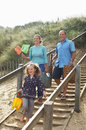 Family walking wooden steps at beach couple with daughter down on Royalty Free Stock Photo
