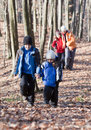 Family walking in the woods Royalty Free Stock Photography