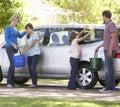 Family washing car together Royalty Free Stock Image