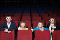 Family watching a movie in d cinema with popcorn Stock Image