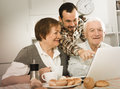 Family watching news in Inet Royalty Free Stock Photo
