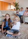 Family watching television in the living room Stock Photo