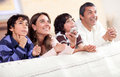 Family watching tv Stock Images