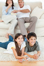 Family watching tv in the living room Royalty Free Stock Image