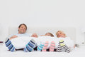 Family wearing stripey socks at home in bed Royalty Free Stock Photo