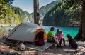 Family wilderness camp a of three and their dog enjoying a lakeside camping adventure Royalty Free Stock Photo