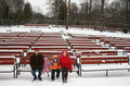 Family on winter bench Royalty Free Stock Photo