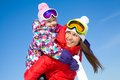 Family winter playing portrait of smiling women with cute little girl in wintertime Royalty Free Stock Images