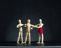 Family of wooden figures in circle Royalty Free Stock Photo
