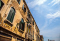 Famous architectural monuments and colorful facades of old medieval buildings close-up n Venice, Italy. Royalty Free Stock Photo