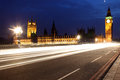Famous and beautiful night view to big ben and houses of parliam parliament with westminster bridge through traffic london uk Royalty Free Stock Images