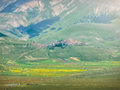 Famous Castelluccio di Norcia with beautiful mountain landscape, Italy Royalty Free Stock Photo