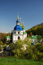 Famous churches of kiev orthodox church is sunlit in the middle spring park beautiful edifice is buried in verdure Royalty Free Stock Photos