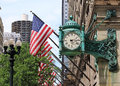 Famous clock in chicago downtown with american flags Royalty Free Stock Photo
