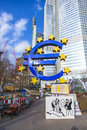 Famous euro sign in frankfurt germany feb big and banner let us speak about future of the occupy movement at the european central Royalty Free Stock Photos