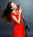 Famous female jazz singer singing in retro mic Royalty Free Stock Photography