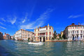 The famous grand canal in venice foreground is a graceful white yacht photo taken by lens fisheye Royalty Free Stock Images