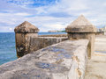 The famous malecon seawall in havana with el morro castle on background Royalty Free Stock Photo