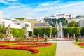 Famous mirabell gardens in salzburg austria with the old historic fortress hohensalzburg the background Royalty Free Stock Images
