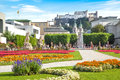 Famous mirabell gardens in salzburg austria with the old historic fortress hohensalzburg the background Royalty Free Stock Image