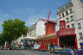 The famous moulin rouge nightclub in monmatre paris france july on a summer day Royalty Free Stock Photos