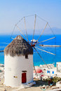Famous mykonos windmill overlooking the town of greece Royalty Free Stock Photo
