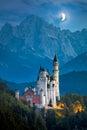Famous Neuschwanstein Castle at night with moon and illumination Royalty Free Stock Photo
