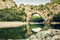 Famous pont d arc at the ardèche in france over river europe toned image this natural bridge is located départment Stock Photos
