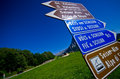 Famous road ascend to alpe di siusi peak signs showing directions of panorama iconic bike Royalty Free Stock Photos