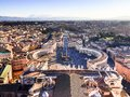 Famous Saint Peter`s Square in Vatican and aerial view of the city Rome, Italy. Located directly in front of St. Peter`s Basilica Royalty Free Stock Photo