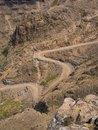 The famous Sani mountain pass dirt road with many tight curves connecting Lesotho and South Africa Royalty Free Stock Photo